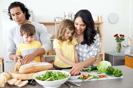 Image of family preparing food.